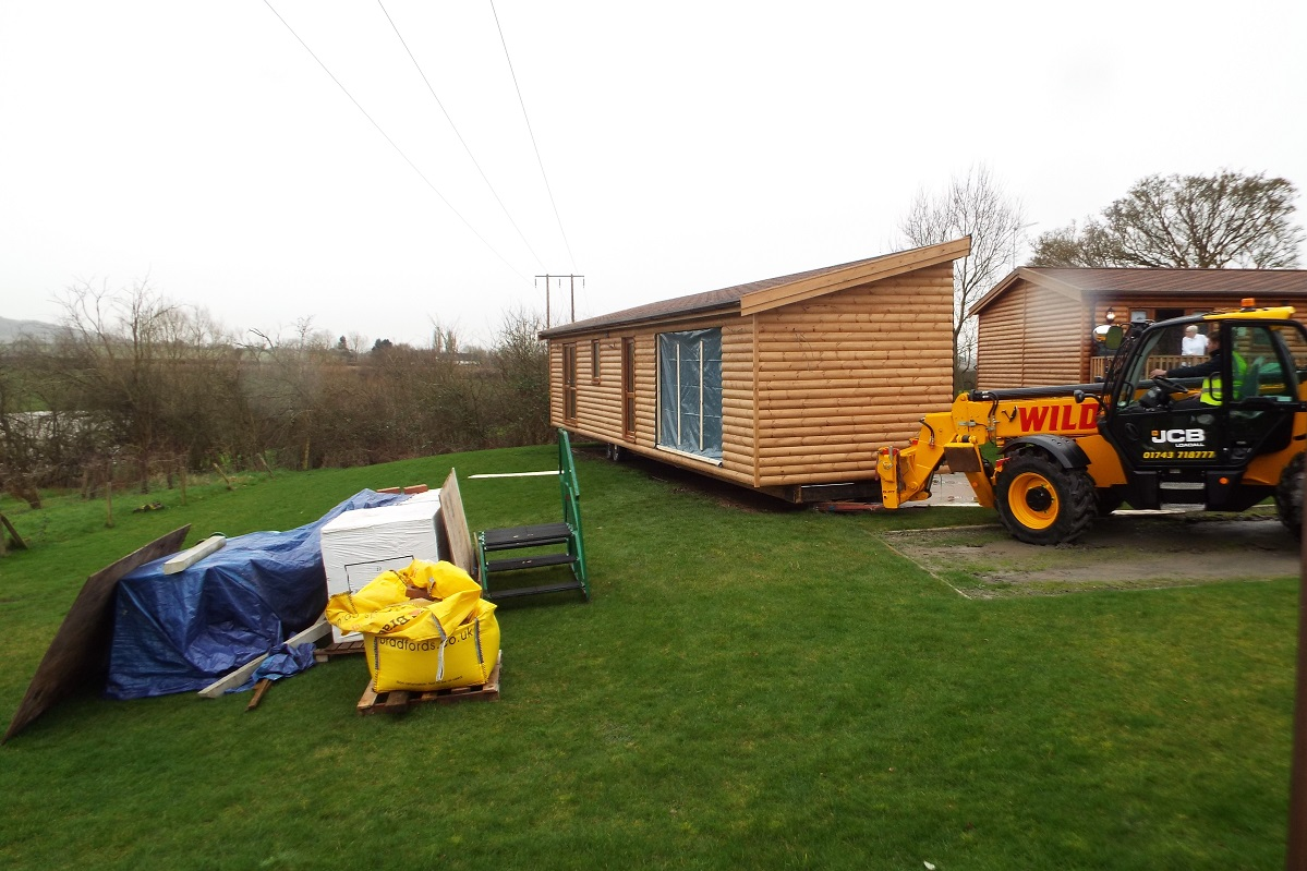Log cabin mobile home delivered and sited this week